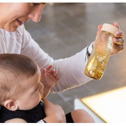 Float Bottle Gold botella sensorial de Petit Boum
